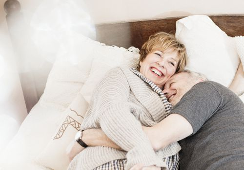 Elderly couple in bed together