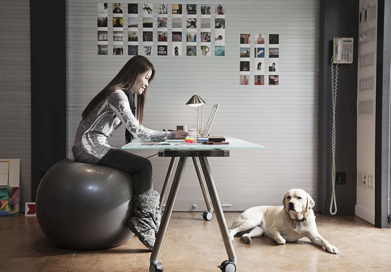 Woman with poor posture working at desk