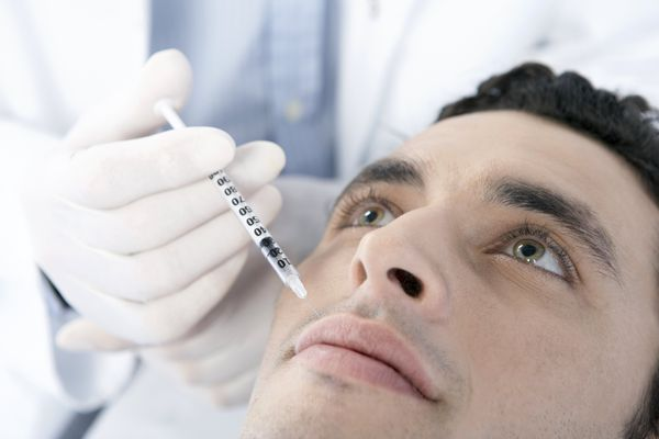 man receiving facial injection