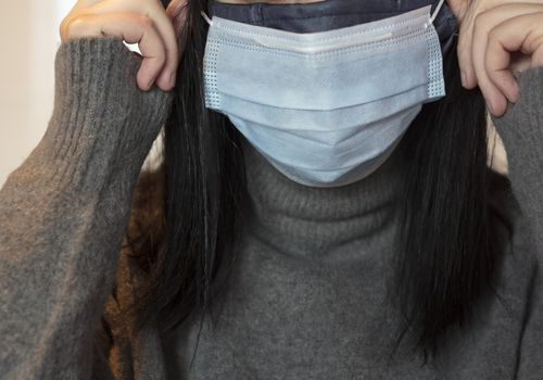 Woman wearing double masks.