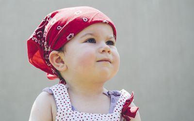 toddler wearing a bandana