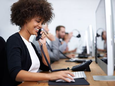 Woman answering phones in call center