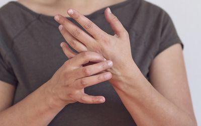 a woman massaging her hand