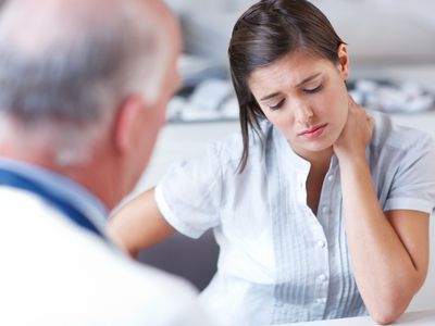 Woman receiving news from a doctor