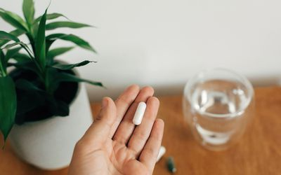 woman holding magnesium supplement