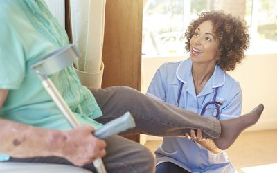 Nurse checks in with patient about knee surgery