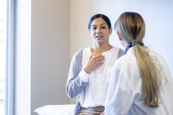 Woman With a Sore Throat at the Doctors stock photo