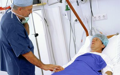 a doctor talking to a patient before surgery