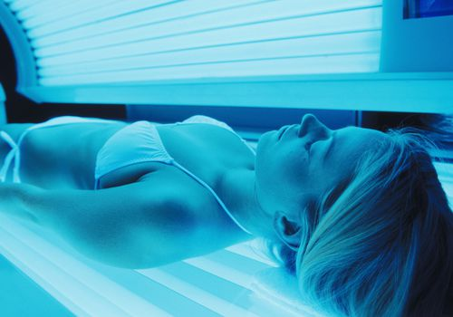 A woman using an indoor tanning bed
