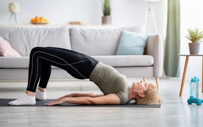 woman performing bridge exercise
