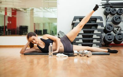 woman doing side leg lift exercise