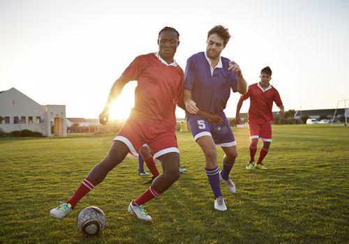 Men playing soccer.