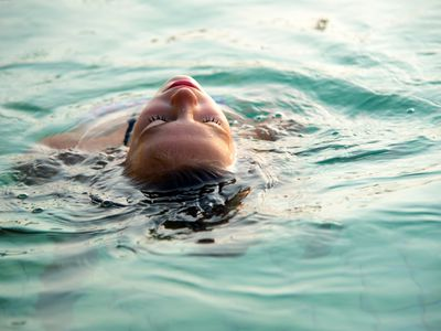 Woman swimming on her back