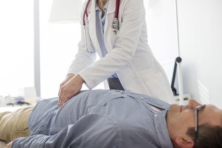 Doctor examining man
