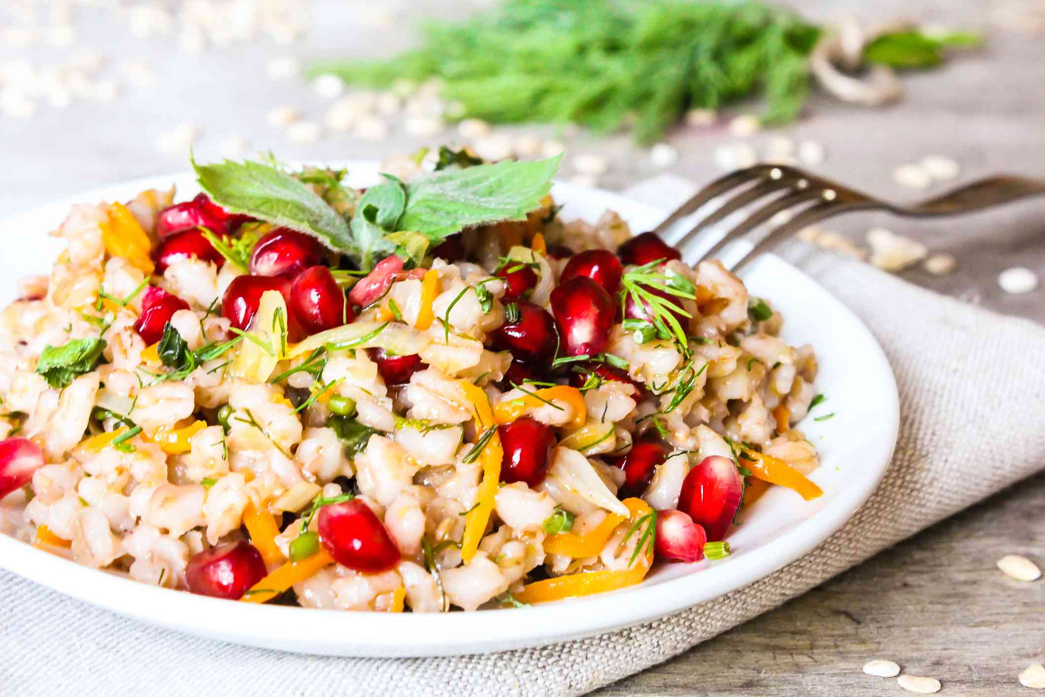 A barley salad with carrots, pomegranate seeds, and fresh mint