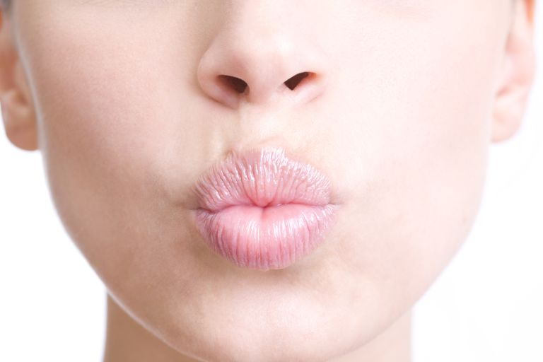 Woman puckering lips
