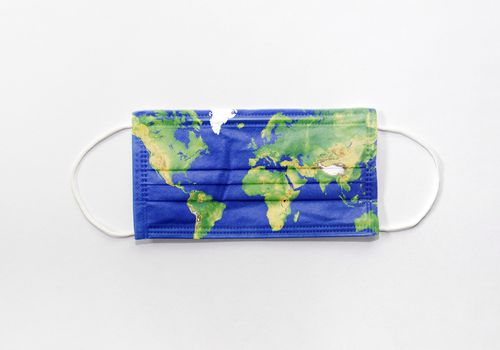 A face mask with a map of the world printed on it on a white background.