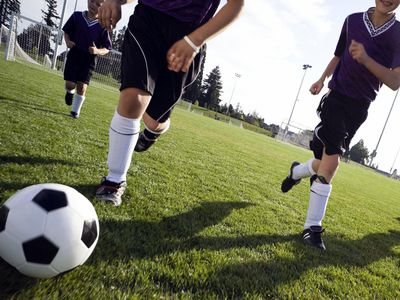 soccer players on field