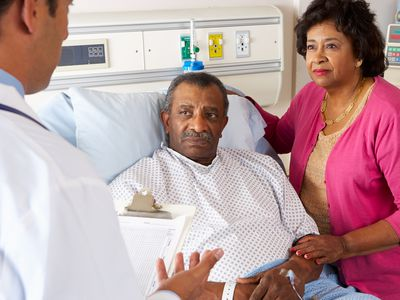 Couple discussing healthcare with a doctor