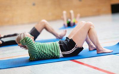 senior woman performing crunch exercise