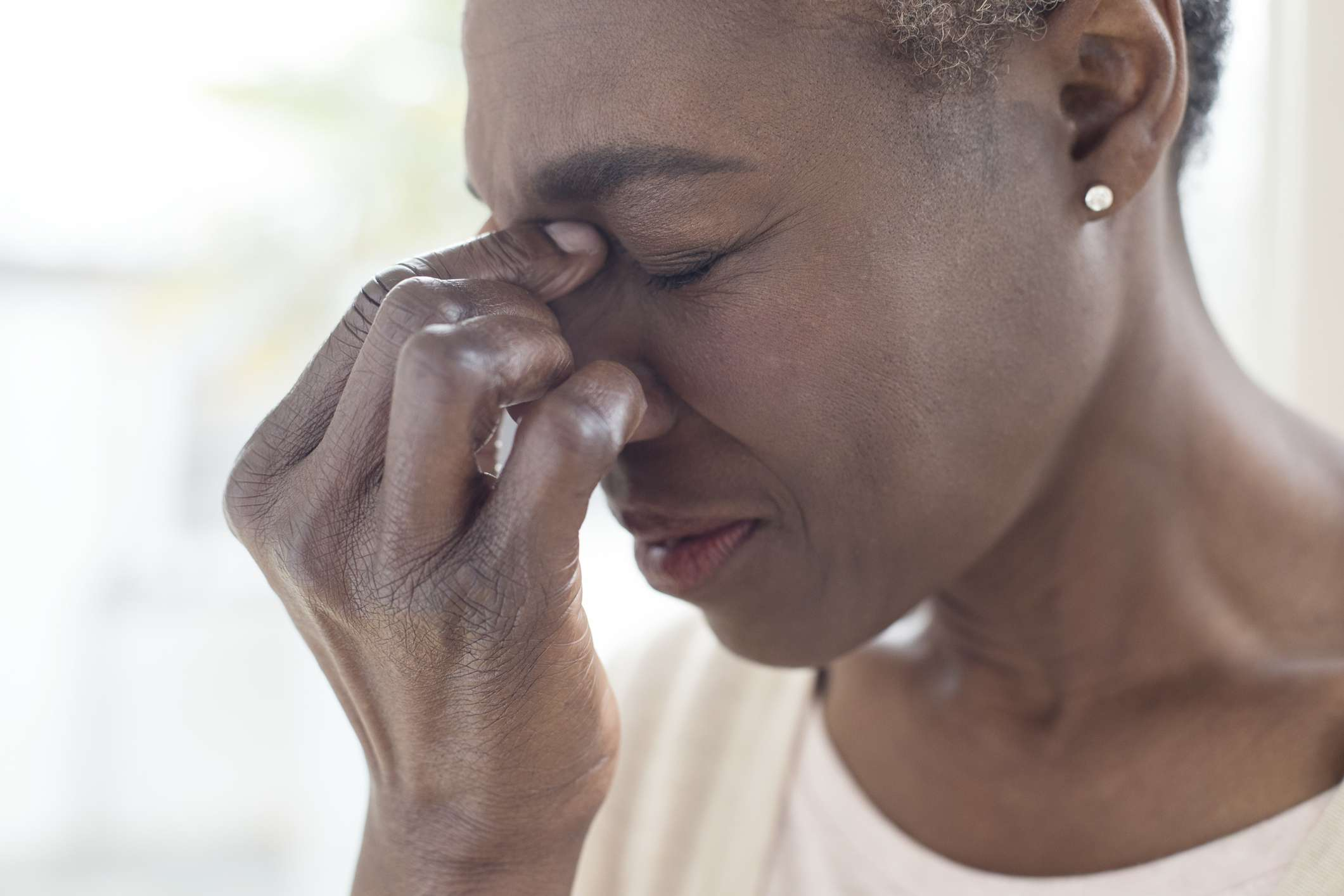 A woman suffering from sinus pain