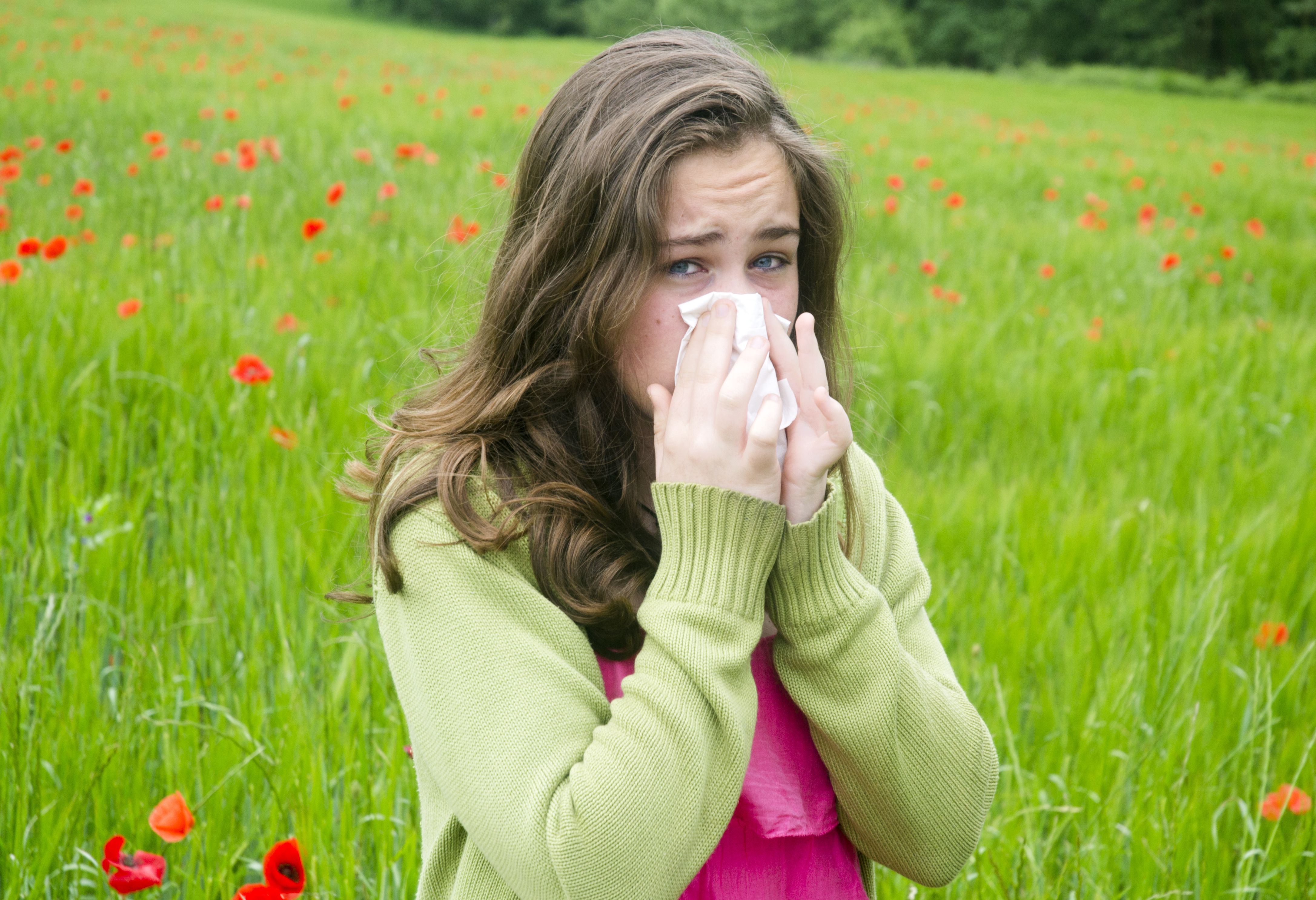 Woman with sinusitis caused by allergies