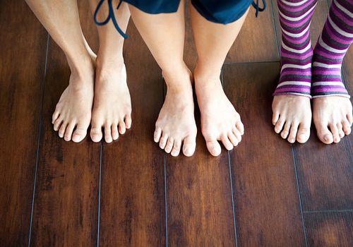Feet on a wood floor.