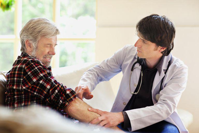 Doctor examining senior man