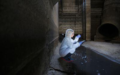 Woman testing sewage wastewater