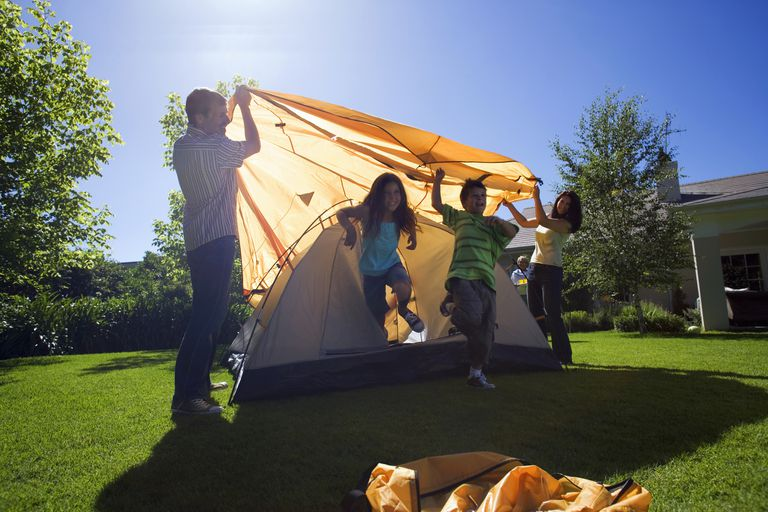 Family setting up a tent