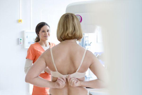woman taking off bra before mammogram