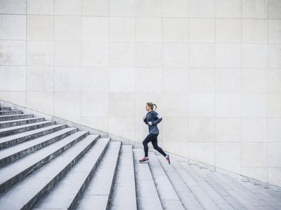 woman running up a flight of stairs