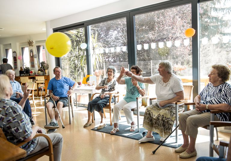 Seniors in a nursing home doing an activity