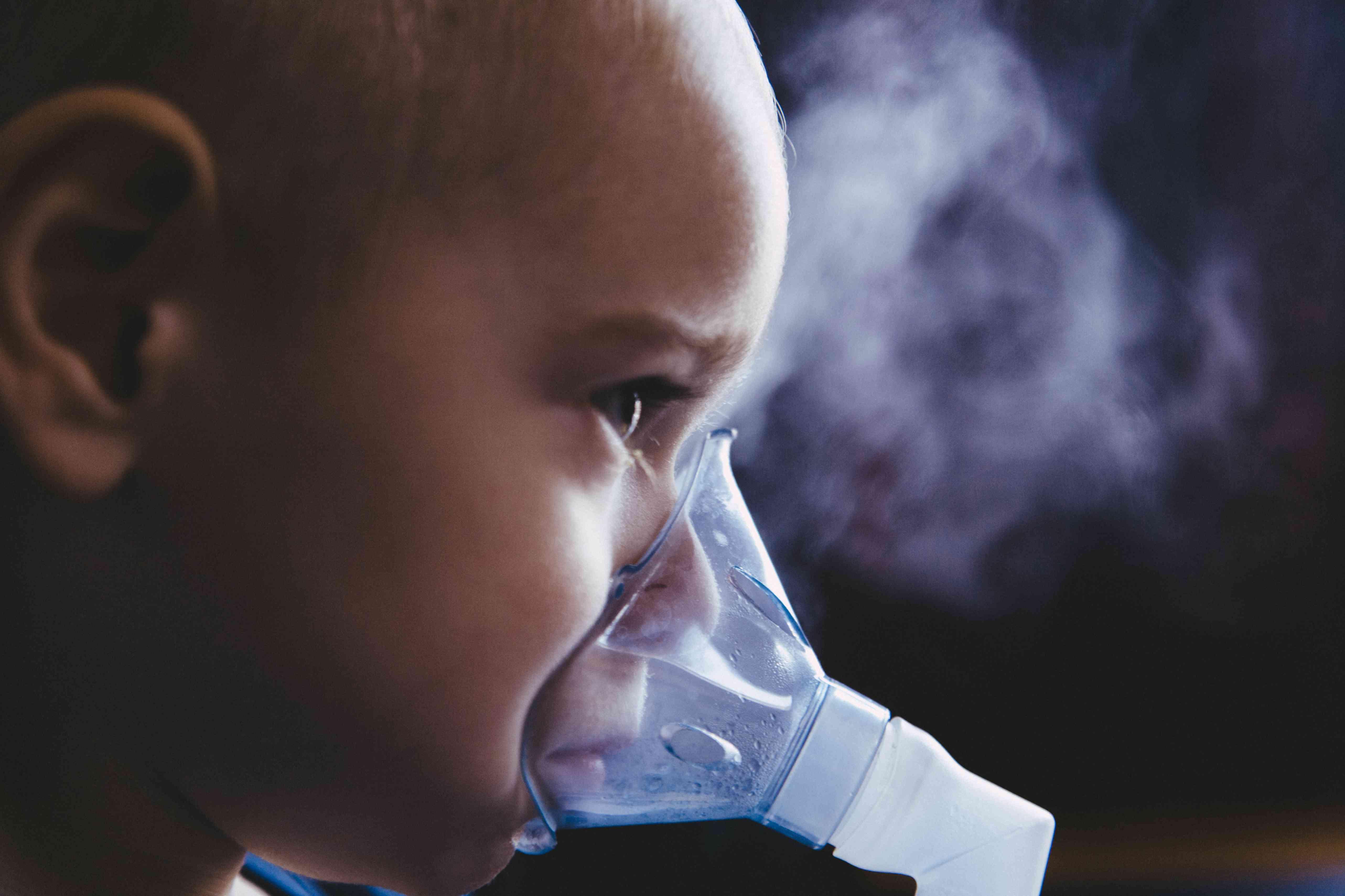 Boy with inhalation mask