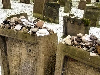 Pebbles and stones on top of Jewish headstones