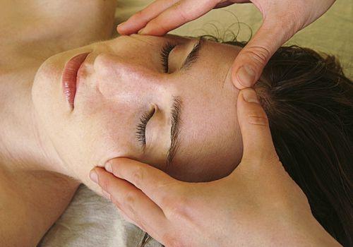 Woman having an acupressure treatment done