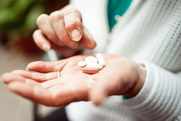 Woman with pills in hand
