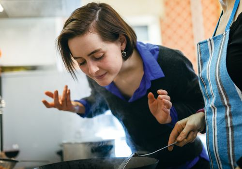 woman smelling food
