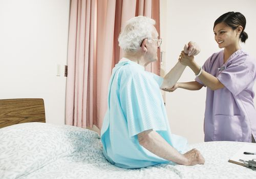 Occupational therapist working with a senior's arm
