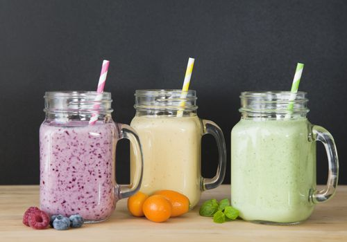 3 glass mugs with different flavored smoothies