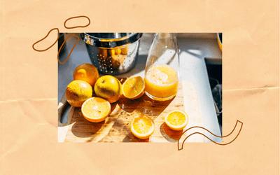 Fresh orange juice and a cutting board.