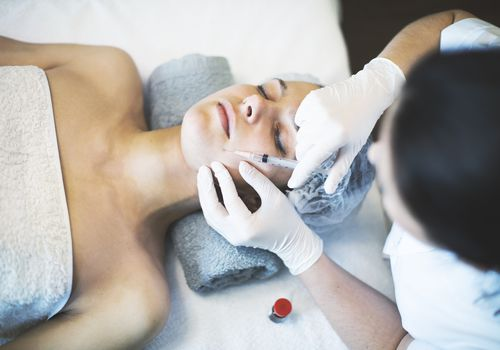 woman undergoing plastic surgery.