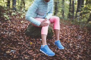Hiker holding sprained knee