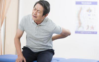 Senior patient suffering from backache