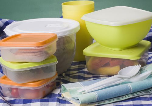 Close-up of picnic foods in plastic containers