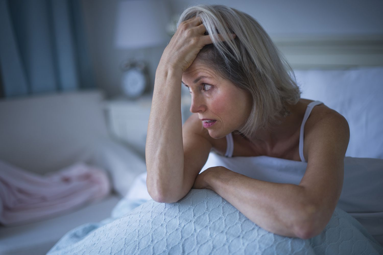 A woman dealing with insomnia in bed