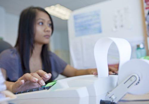Office worker using calculator