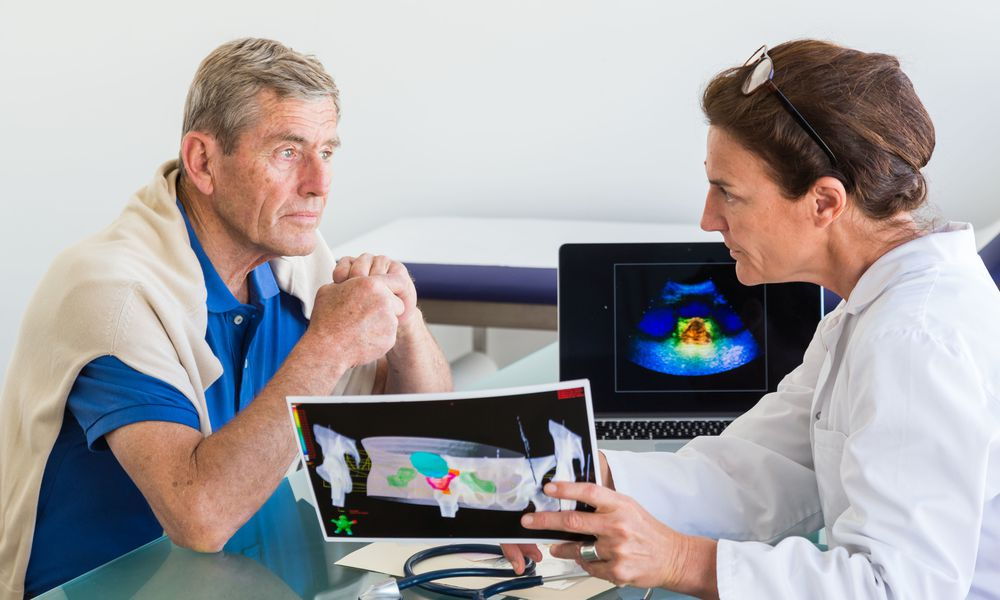 Doctor discussing prostate ultrasound scan with a patient