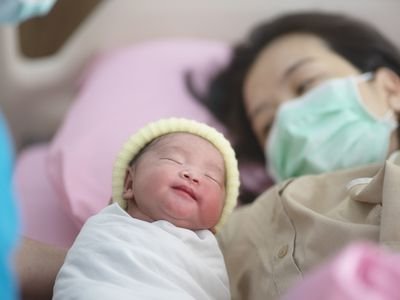 newborn baby with mother