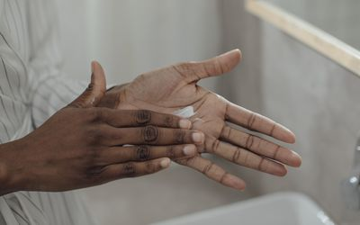 moisturizing hands with lotion